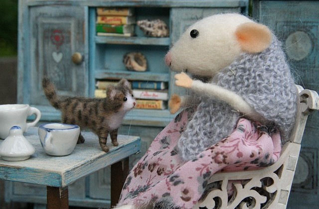 little old lady mouse and her cat at home
